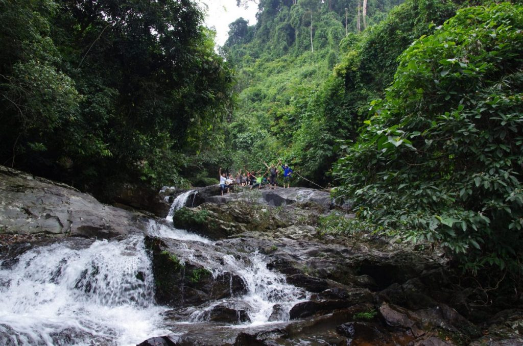 A group of trekkers on top of an unknown-name waterfall on the way trekking to Ba Đờ Phọt Fall, one of the biggest and most popular waterfalls in Da Nang 2019