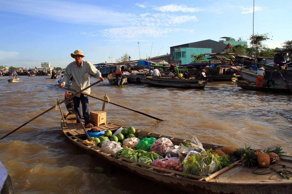Trading on a boat in Mekong floating market