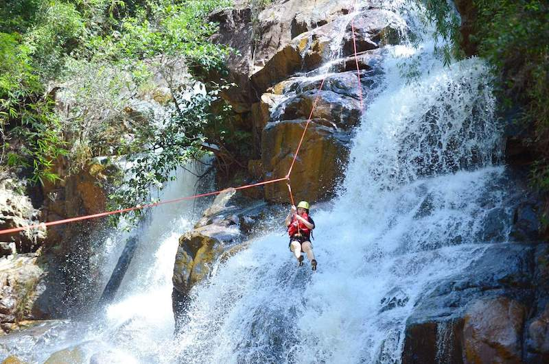 Tourist plays canyoneering at Datanla Waterfall