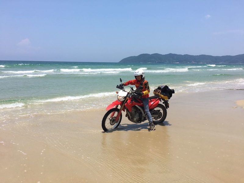Tourist rides enduro motorbike to discover coastal road in Nha Trang