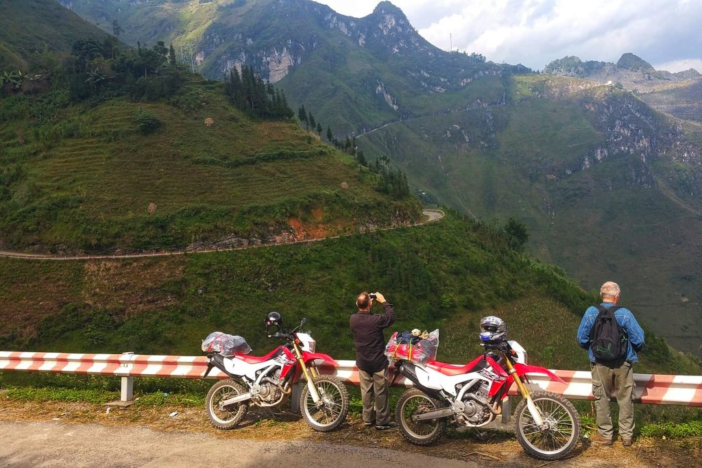 Tourists ride enduro motorbike in the north Vietnam tours